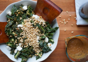 Kale Salad with Goat Cheese, Pine Nuts, and Sweet Caramelized Onion Dressing